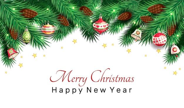 モミ、クリスマスのおもちゃ、鐘、白い背景の上の星とクリスマスツリーの枝