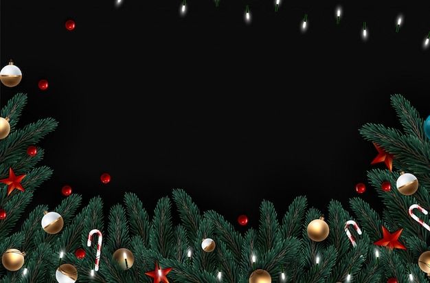 Christmas tree branches on wooden background,