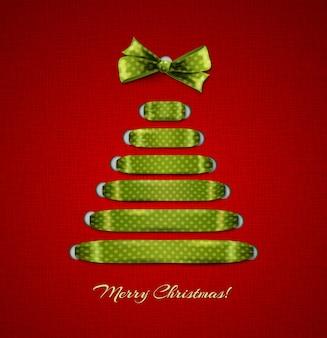 빨간 리본 배경에서 크리스마스 트리입니다.