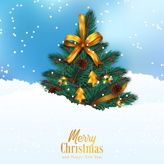 Christmas tree with golden ribbon decoration on the snow and sky blue