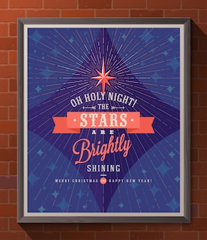 Christmas type design - holiday poster in wooden frame on a brick wall.