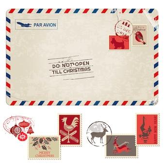 Рождественская винтажная открытка с почтовыми марками