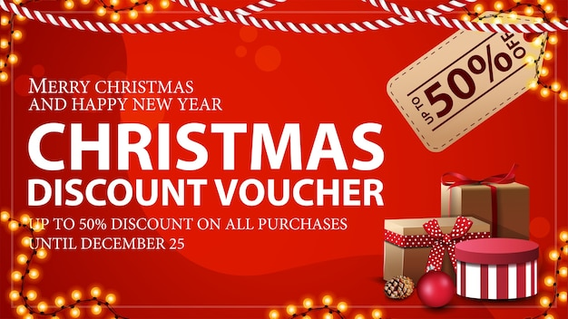 Christmas voucher with large price tag, gifts and garland frame. discount voucher, up to 50 off on all purchases.