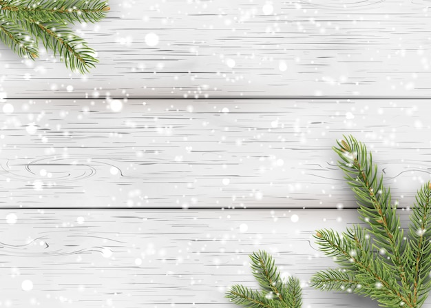Christmas white wooden background with holiday fir tree branches, pine cone and falling shiny snow. flat lay, top view with copy space for your text.