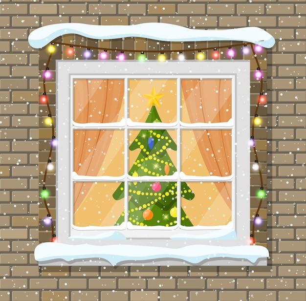 レンガの壁のクリスマスウィンドウ。