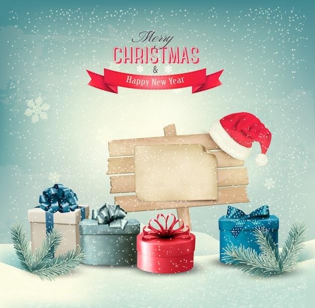 Рождественский зимний фон с подарками и деревянной доской.