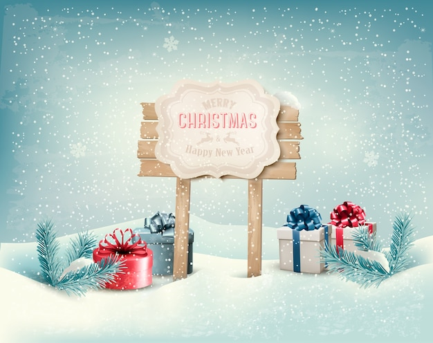 Christmas winter background with presents and wooden board