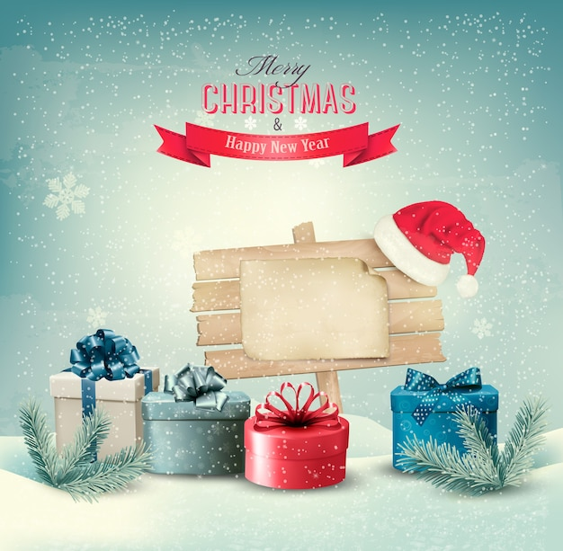 Christmas winter background with presents and wooden board.