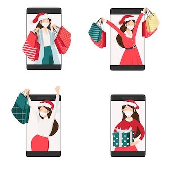 赤と緑のドレスのクリスマスの女性の携帯電話コレクションによるオンラインショッピング