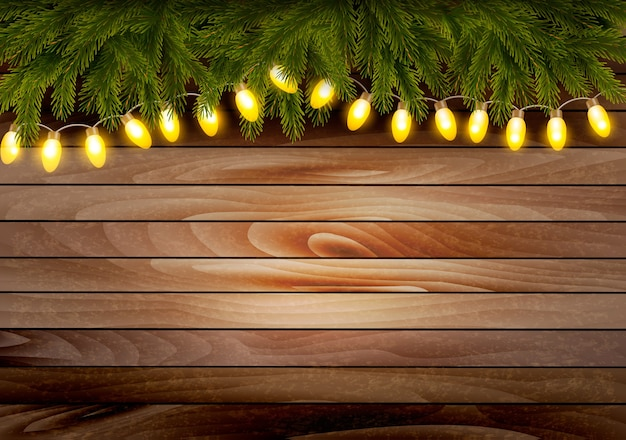 Christmas wooden background with branches and a garland.