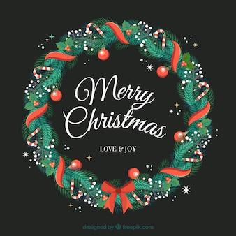 Рождественский венок, украшенный красной лентой Бесплатные векторы