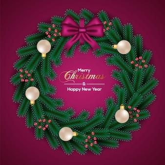 金色のボールの赤い裸のピンクのリボンとクリスマスリースの装飾