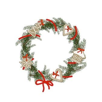Christmas wreath of fir branches with gingerbread in the form of heart, house, snowflake. festive decoration for new year and winter holidays