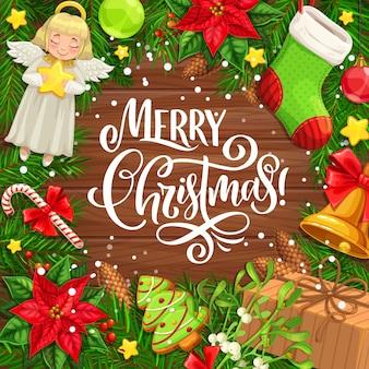 木製の背景のグリーティングカードのクリスマスリース