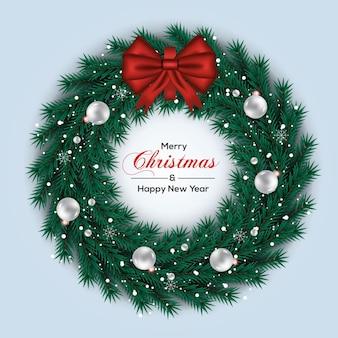 クリスマスリース松の枝白いボールと赤いリボン
