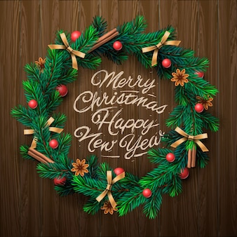 Christmas wreath with garlands, merry christmas and happy new year lettering.