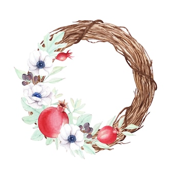 Christmas wreath with pomegranate and anemone flowers