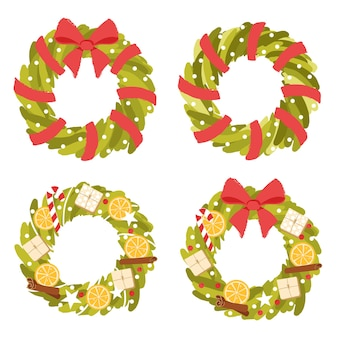 Christmas wreaths collection of fir branches set with bright red ribbon bow and holiday attributes