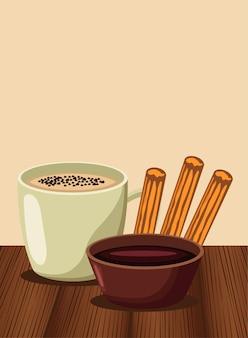 チョコレートとカップの甘い食べ物とチュロス