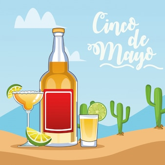 Празднование синко де майо с бутылкой текилы и чашками