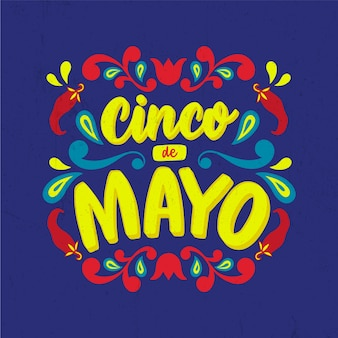 Cinco de mayo lettering with chili peppers