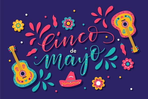 Надпись синко де майо с изображением гитар