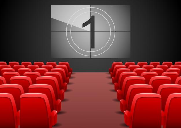 赤座席と映画スクリーンを備えたシネマオーディトリアム