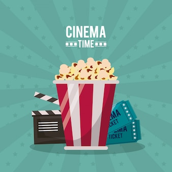 Cinema time with clapperboard and tickets behind the popcorn