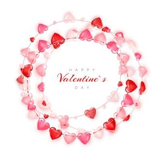 赤とピンクのハートのサークルデコレーションガーランド。バレンタインデーのグリーティングカードまたはバナーテンプレート。