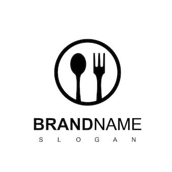 サークルスプーンレストランとカフェのシンボルのフォークのロゴ