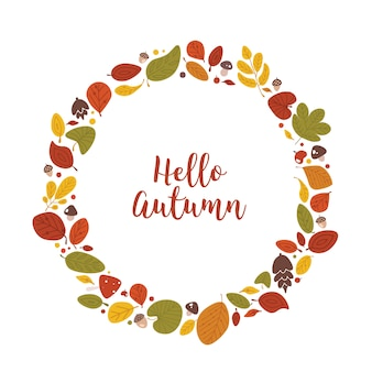 Circular frame, garland, wreath or border made of fallen dried leaves, acorns, cones and hello autumn lettering handwritten with cursive calligraphic font