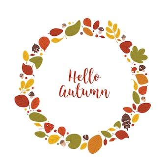 円形フレーム、ガーランド、リース、または乾燥した落ち葉、どんぐり、コーン、筆記体の書道フォントで手書きされたこんにちは秋のレタリングで作られた境界線