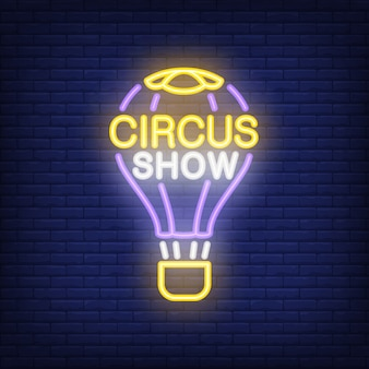 Circus show neon sign. Hot air balloon in bright inscription on dark brick wall background