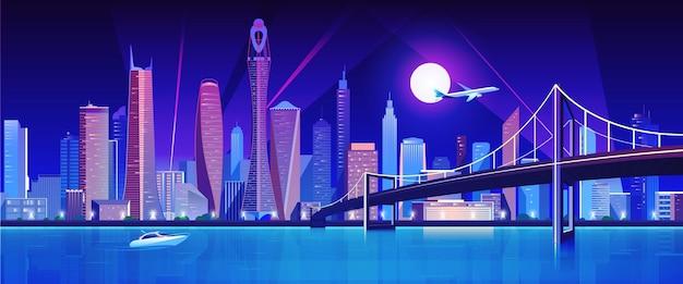 밤에 물 베이 위에 도시 다리
