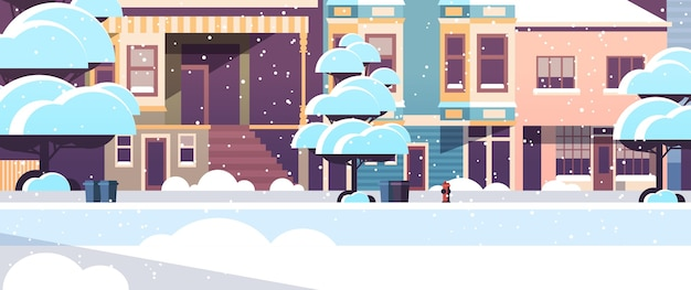 市建物住宅冬の季節の夕暮れの降雪の街並みの外観のモダンな町雪に覆われた通り