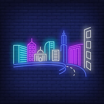 City buildings and road neon sign.