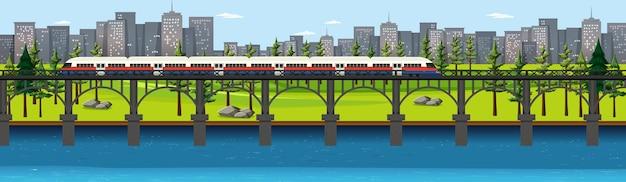 Parco naturale della città con il treno sulla scena del paesaggio dell'orizzonte