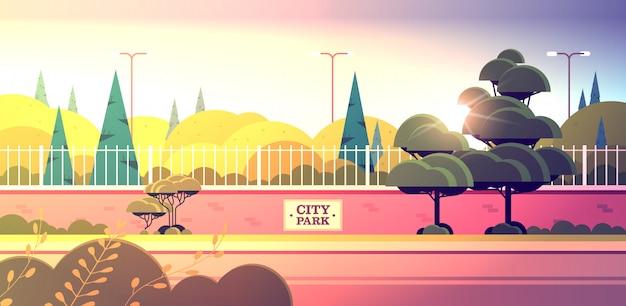 City park sign board on fence beautiful summer day sunset landscape background horizontal