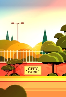 City park sign board on fence beautiful summer day sunset landscape background vertical