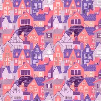 春に手描きの古いヨーロッパの家と街のシームレスなカラフルなパターン。