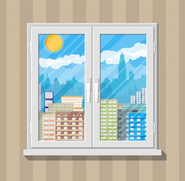 City skyline at day behind window