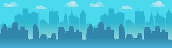 City skyline illustration, blue city silhouette.