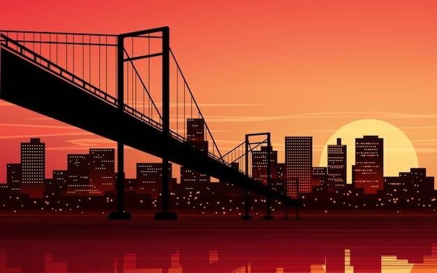 Городской пейзаж заката с мостом