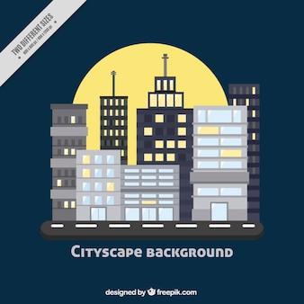 평면 디자인에 달과 도시 배경