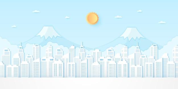 青い空と明るい太陽、紙のアートスタイルの街並み、建物、山