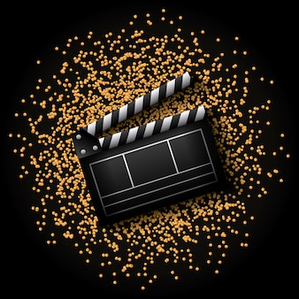 Clapboard icon over golden dots and black background