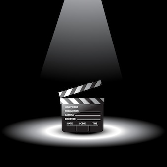 Clapperboard in light focus