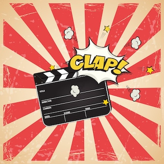 Clapperboard with clap word on vintage striped pop art background.