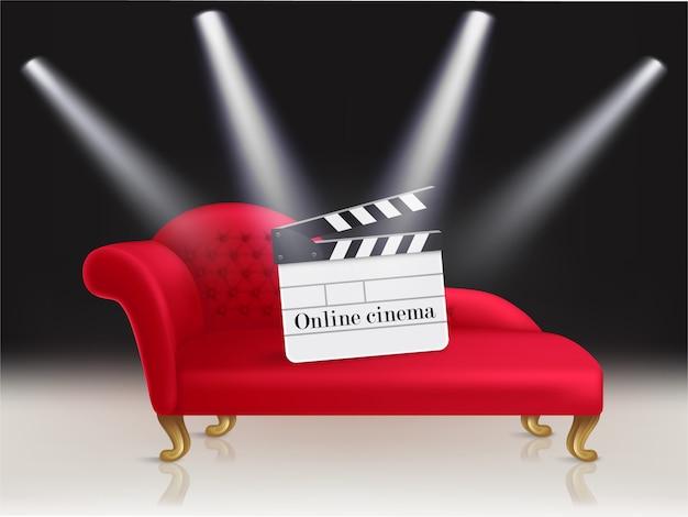 赤いベルベットのソファーとそれにclapperboardとオンラインシネマのコンセプトイラスト