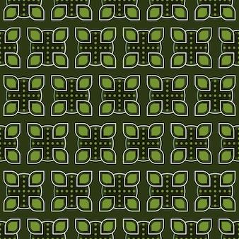 古典的なバティックのシームレスなパターン背景。豪華な幾何学的なマンダラの壁紙。緑の色でエレガントな伝統的な花のモチーフ